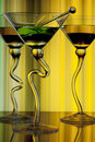Colorful alchol in curved glasses Royalty Free Stock Photo