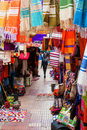 Colorful alley in the souks of essaouira with hanging fabrics unesco protected Stock Photo