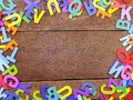 Colorful alphabet letters on wooden background concept Royalty Free Stock Photo