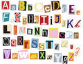 Colorful alphabet from newspapers Stock Images
