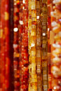 Colorful amber necklaces closeup of red and hung on market stall Stock Photography