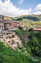 Colorful antic old village with roman ruins and hills on a cloud italian town of tivoli houses ancient hilly ground cloudy day Stock Image