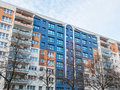 Colorful Apartment Building with Bare Trees
