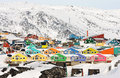 Colorful arctic houses painted in vivid colors make the settlement seem joyful Stock Images