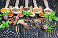 Colorful aromatic spices and herbs on an old wooden backgrownd oak brown Stock Photos