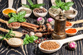 Colorful aromatic spices and herbs on an old wooden backgrownd oak brown Stock Images