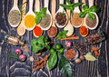 Colorful aromatic spices and herbs on wooden brown backgrownd an old oak Royalty Free Stock Images