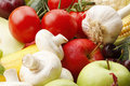 Colorful assorted fruits and vegetables various apple garlic mushrooms tomato vibrant color Royalty Free Stock Photo