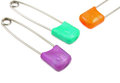 Colorful baby pins close up of safety arranged on white Royalty Free Stock Photo