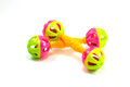 A colorful baby rattle on a white horizontal background Royalty Free Stock Photo