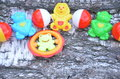 A colorful baby rattle on a wooden background Royalty Free Stock Photo