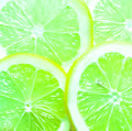 Colorful background of green limes sliced juicy rich in vitamin c with a tangy flavor used as an ingredient and garnish in cooking Stock Photo