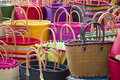 Colorful bags at marketplace multiple colour straw together Royalty Free Stock Images