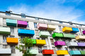 Colorful balconies on a modern apartment building against great blue sky Royalty Free Stock Image