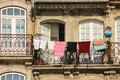 Colorful balcony with clothes hanging porto portugal detail of a picturesque and building iron balconies along cais da ribeira Stock Photo
