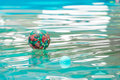 Colorful ball floating in a pool Royalty Free Stock Image