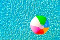 Colorful ball floating in a pool beach Royalty Free Stock Image