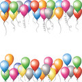 Colorful balloons flying in sky Stock Photo