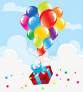 Colorful balloons and a gift box Royalty Free Stock Photos