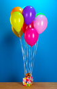 Colorful balloons holding a gift Royalty Free Stock Photography