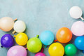 Colorful balloons on vintage blue table top view. Birthday or party background. Flat lay style. Copy space for text. Royalty Free Stock Photo
