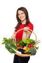 Colorful basket beautiful young woman posing with full of vegetables isolated on white Stock Photo