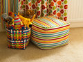 Colorful basket with plush toys curtain and seat detail of a colourful plastic in a child s bedroom full of set against a beanbag Stock Photos