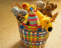 Colorful basket with plush toys detail of a colourful plastic in a child s bedroom full of Royalty Free Stock Photo
