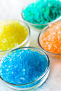 Colorful bath salt in glass bowl Stock Images