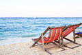 Colorful beach chairs on the beach white sand Stock Photos