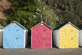 Colorful beach huts at seaton devon uk a set of three brightly colored Royalty Free Stock Photo