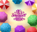 Colorful Beach Umbrellas Background with Summer Time Title in Sea Shore Royalty Free Stock Photo