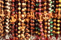 Colorful beads with tau cross the franciscan symbol Royalty Free Stock Images