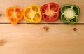Colorful bell peppers on wooden shelf Stock Photos