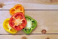 Colorful bell peppers on wooden shelf Royalty Free Stock Image