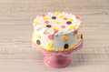 Colorful birthday cake on vintage pink plate Royalty Free Stock Photos