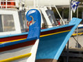 Colorful boats in greek harbor Stock Image