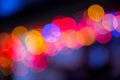 Colorful bokeh on a dark background. Defocused bokeh lignts. Abstract Christmas batskground. Abstract circular bokeh background of Royalty Free Stock Photo