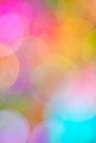 Colorful bokeh a soft dreamy background in a blend of fuchsia pink blue yellow green mauve Stock Photo