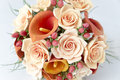 Colorful bouquet of orange calla lilies on a white Royalty Free Stock Photo