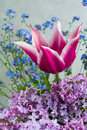 Colorful bouquet with purple lilac, pink tulip and blue forget-m