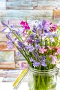 Colorful bouquet with spring wild hyacints and another meadow f Royalty Free Stock Photo