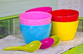 Colorful bowl color with spoon on table Royalty Free Stock Images