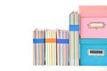 Colorful boxes and binder with blank label on white background Royalty Free Stock Images