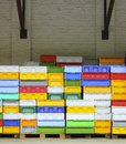 Colorful boxes plastic crates containers for fish packing piles storage of catch Stock Photos