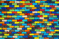 Colorful brick wall beautiful variety colors red green yellow blue cement pattern background Stock Images