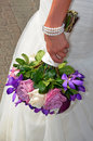Colorful bridal bouquet bride s hand holding Royalty Free Stock Image