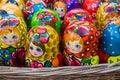 Colorful bright russian nesting dolls Matrioshka in the basket at the street market at Old Arbat street, iconic popular souvenir f