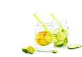 Colorful and bright style infused detox water detox diet lemon and cucumber on white background blank text soft focus Royalty Free Stock Photos