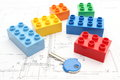 Colorful building blocks and key on housing plan lying construction drawing of house Royalty Free Stock Photography